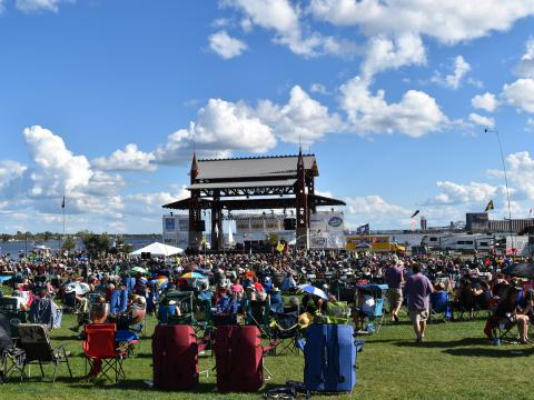 Fans enjoying live music with waterfront views at Duluth's Bayfront Blues Festival