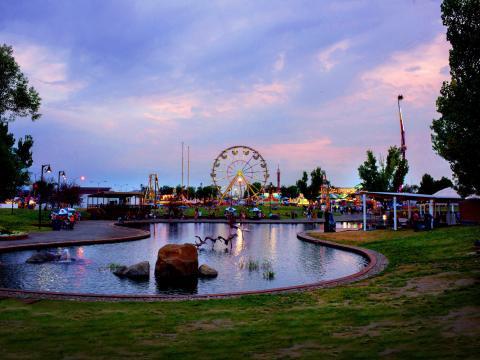 The sun setting over the Montana Fair