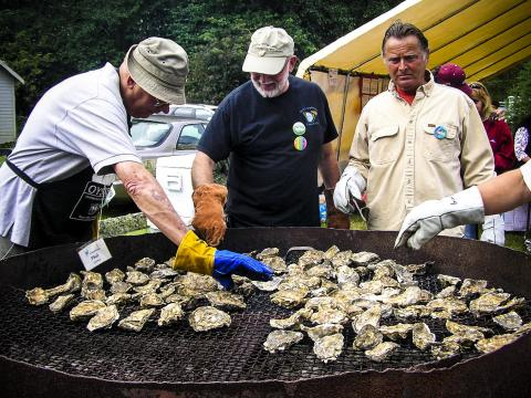 Cooking chargrilled oysters during the Jazz & Oysters event in Ocean Park