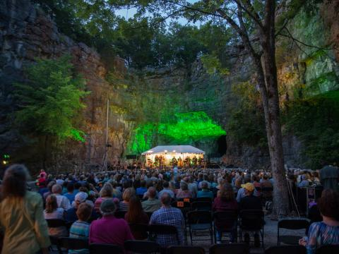 A live music performance in a cave during the Three Caves Concert Series in Huntsville, Alabama