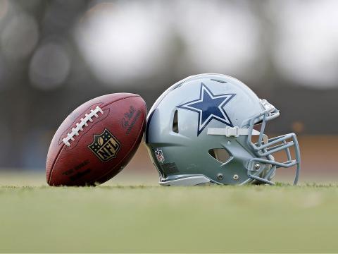A football and a Dallas Cowboys helmet at the training center in Oxnard, California