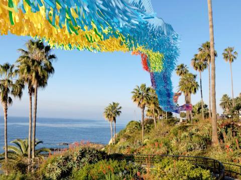 A colorful installation and coastline views during the Art & Nature Festival in Laguna Beach, California