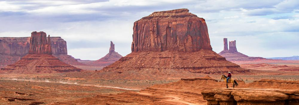 Horseback rider overlooking Monument Valley, Utah
